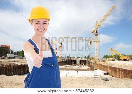 Happy Woman Builder In Blue Coveralls Thumbs Up