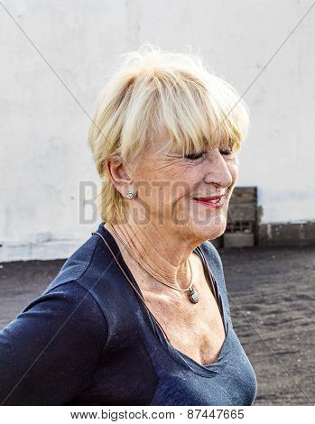 Happy Attractive Senior Woman In Landscape