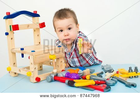 adorable child playing with wooden building toys