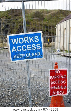 Signs On The Boundary Fence Of A Building Site