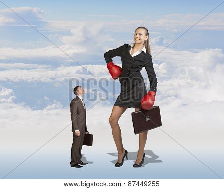 Small Businessman Staring at Giant Businesswoman