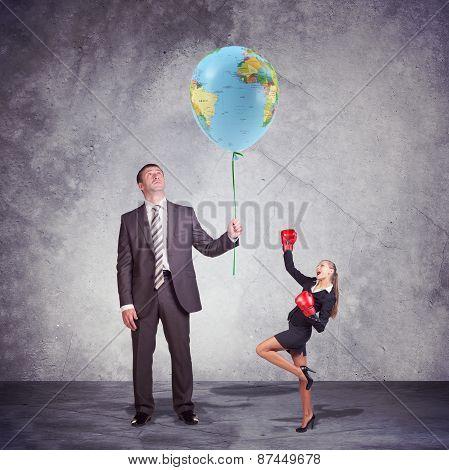 Small and Tall Executives Looking at World Balloon