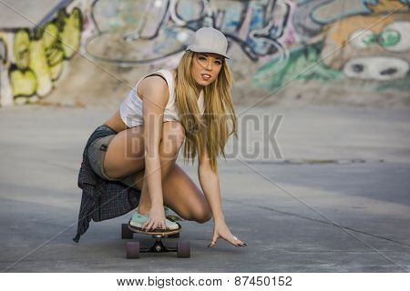 Young woman riding a skateboard