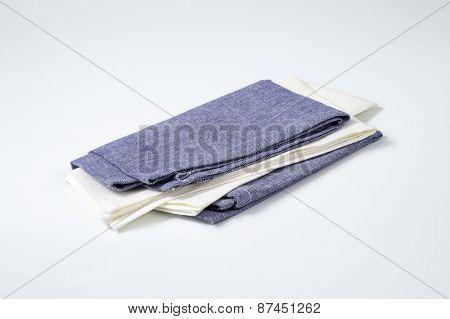 blue and white napkins on white background
