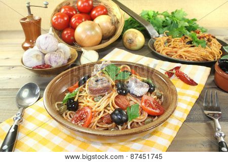 Spaghetti Alla Puttanesca With Capers And Tomatoes