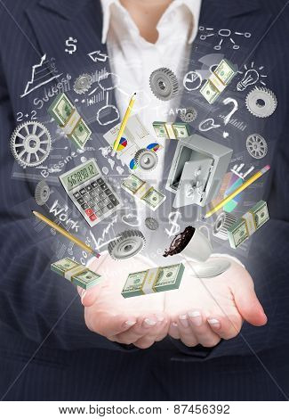 Businnes Concept. Woman Hand Hold Elements Of Business In The Light.