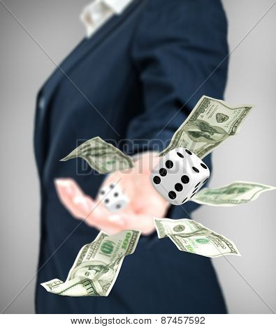 Close Up Of Businessman Throwing Dice And Dollars. Gambling Concept.