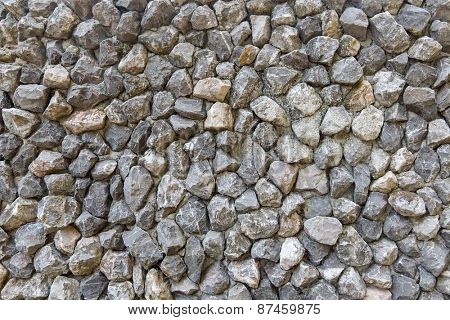 background, design and texture concept - grainy stone decorative tile texture