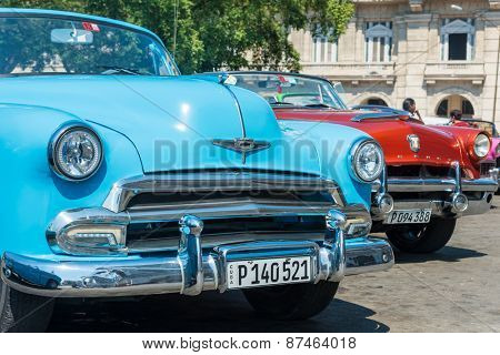 HAVANA,CUBA - APRIL 3, 2015 : Colorful classic american cars parked in Old Havana