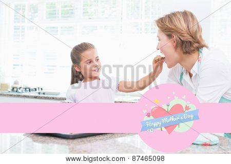 mothers day greeting against mother and daughter with hot fresh cookies