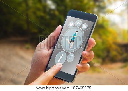 hand holding smartphone against tarmac curved country road in forest