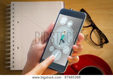 hand holding smartphone against overhead of notepad and pen