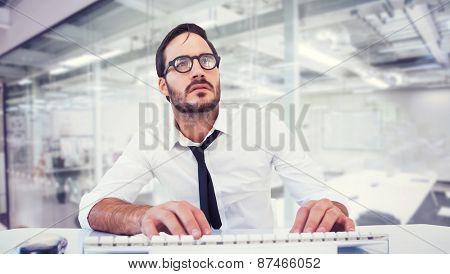 Business worker with reading glasses on computer against classroom