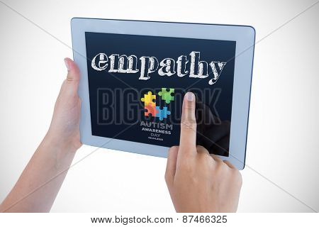 The word empathy and woman using tablet pc against autism awareness day