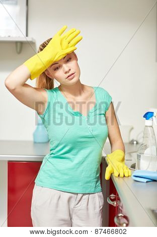 people, housework and housekeeping concept - tired woman cleaning home kitchen