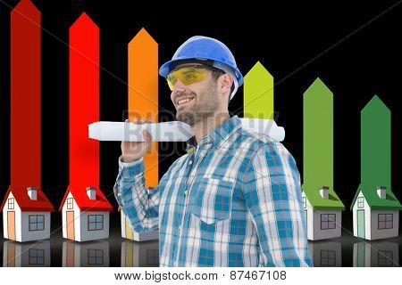 Smiling architect looking away while holding blueprint against seven 3d homes representing energy efficiency