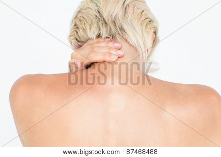 Attractive woman suffering from neck pain on white background