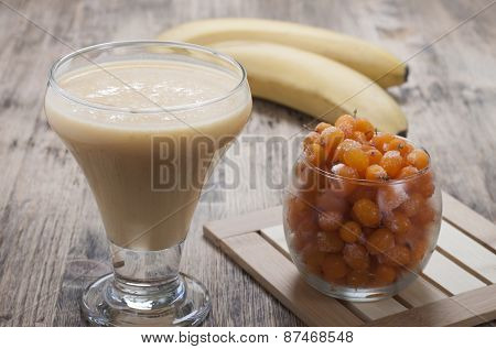 Smoothies Of Sea Buckthorn And Bananas In A Glass.