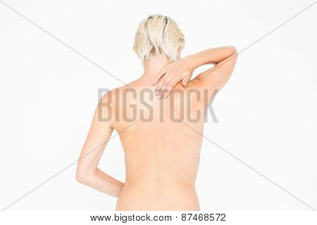 Pretty woman suffering from neck pain on white background