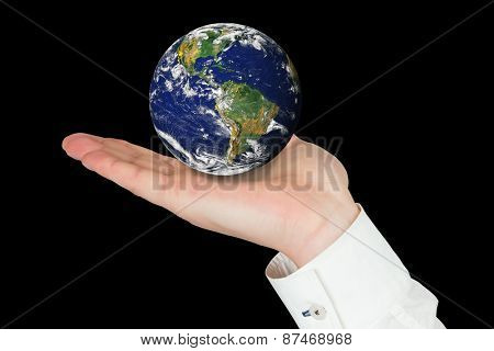 Hand presenting against planet earth