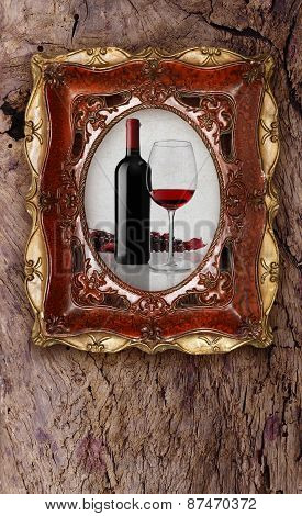 Bottle And Glass Wine In Old Picture Frame On Wood Background