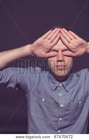 man covering face with his both hands