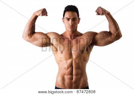 Handsome bodybuilder doing biceps pose, isolated on white