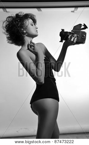 Black and white photo of woman with photocamera
