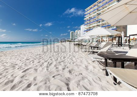 Vacation On Caribbean Beach With Sun Umbrellas And Beds