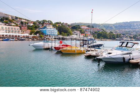 Yachts And Pleasure Motor Boats Are Moored In Marina