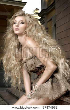 Girl with long blonde hair in city