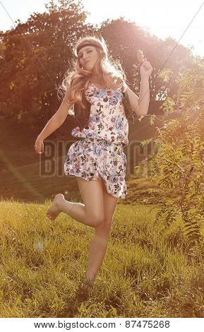 Blonde woman in sundress enjoying summer day