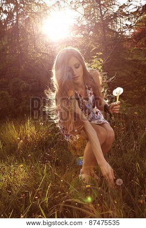 Blonde girl in sundress enjoying summer day
