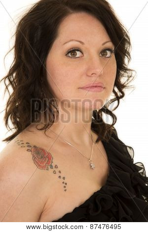 Woman In Black Top Bare Shoulder With Tattoo Looking