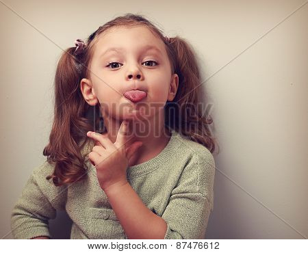 Thinking Grimacing Girl Showing Tongue With Finger. Vintage Closeup