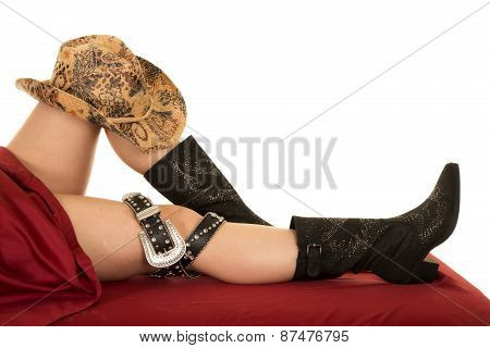 Woman Legs Under Sheet Hat Boot And Belt Buckle