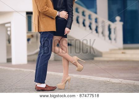 Young couple in love kissing outdoors in the summer.