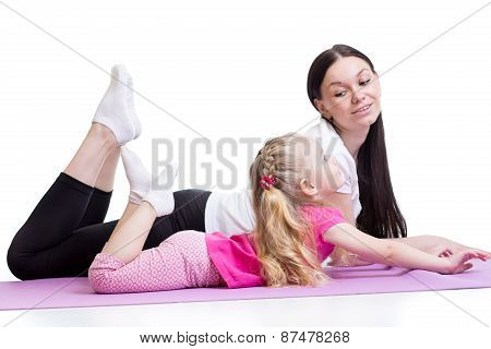 Mother Does Physical Yoga Exercises Together With Child