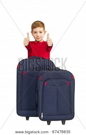 Portrait Of Smiling Boy Showing Thumbs Up With Travel Bags