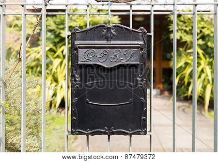 Close Up Black Metal Post Box Hanging On Railings