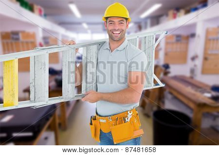 Portrait of smiling repairman carrying ladder against workshop