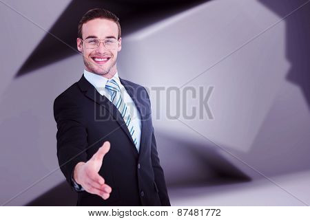 Businessman smiling and offering his hand against abstract grey room