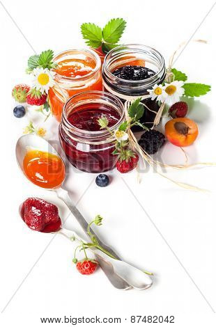Apricot ,blackberry and strawberry jam on white background