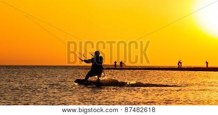 Kite Surfing At Sunset In The Sea