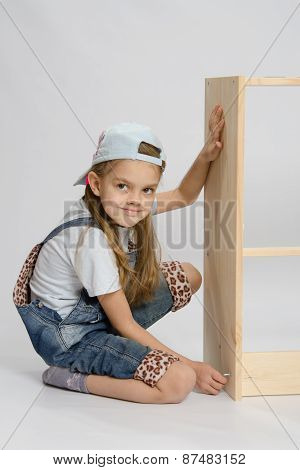 Little Girl In Overalls Collector Of Furniture Turn Screw On Dresser