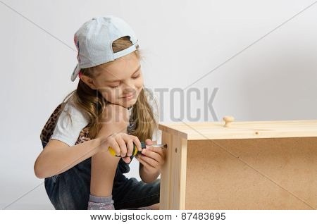 Little Girl In Overalls Collector Of Furniture Screws Screwdriver Screw