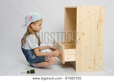 Girl In Overalls Furniture Collector Tries To Insert Drawer A Chest Of Drawers