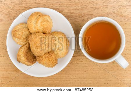Butter Cookies In White Saucer And Tea