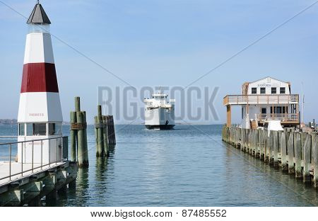 PORT JEFFERSON, NY - April 6, 2015: Auto Ferry arriving at port. The ferry 'Park City' arrives at Port Jefferson, New York from Bridgeport Connecticut. The boat carries 95 vehicles and 1000 passengers