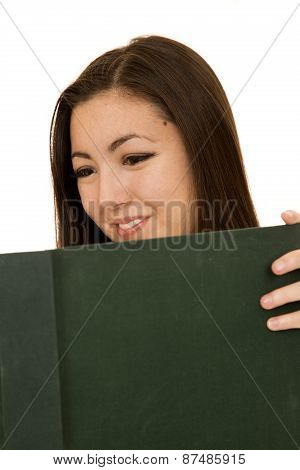 Cute Female Student Reading A Large Text Book Smiling